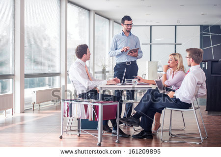 stock-photo-business-people-sitting-at-corporate-meeting-161209895
